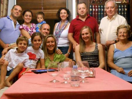 Posing with my host parents and their family after a typical, Saturday night dinner.