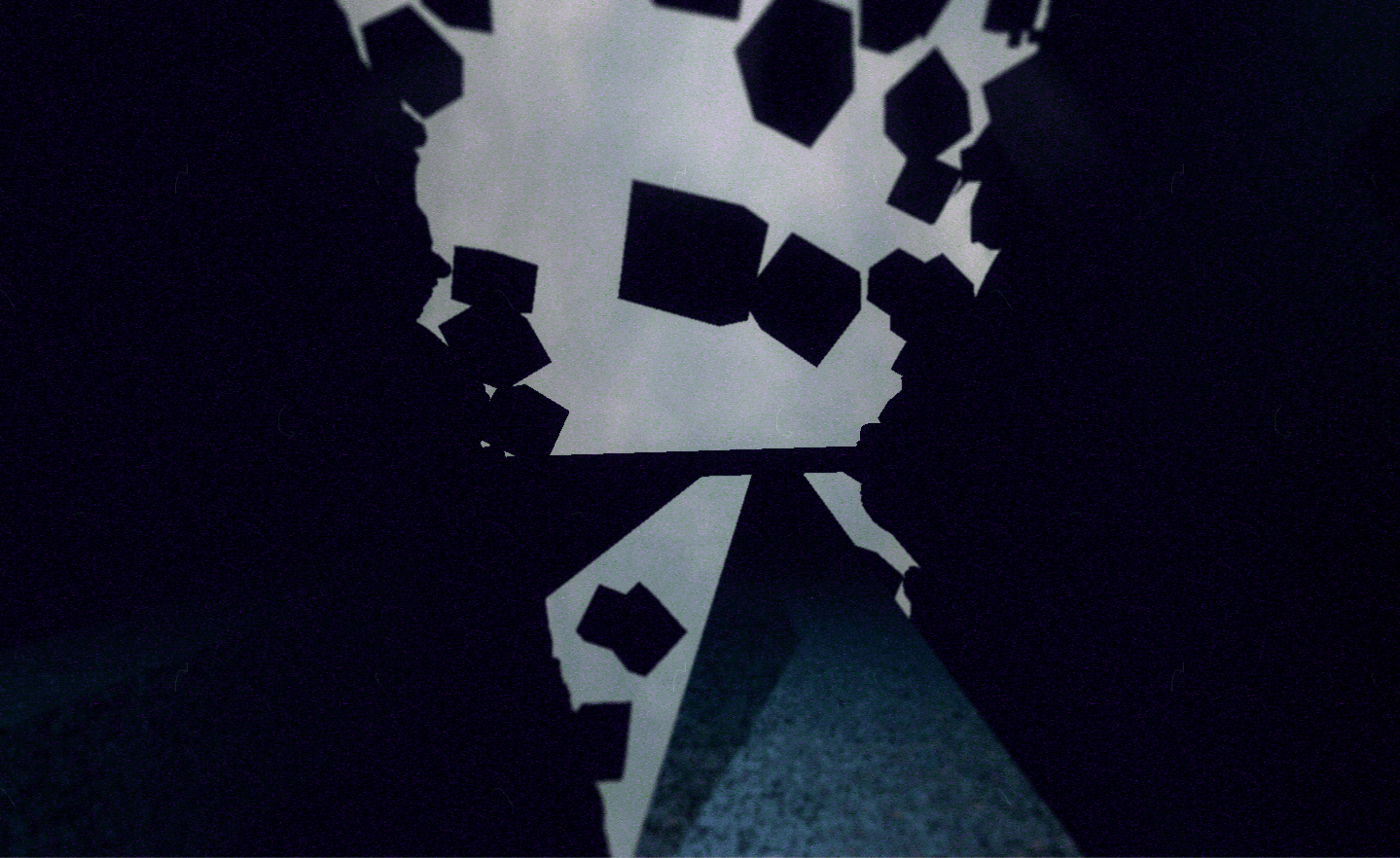 A black, stone walkway leads forward towards a fractured wall made of floating cubes, silhouetted against a sky at dawn