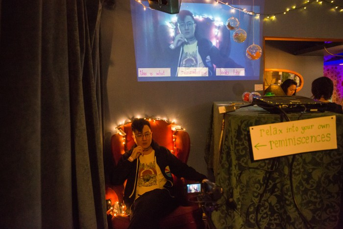 """Video installation that provided visitors with a private corner and armchair to reminisce in. A live feed projected them into the space for others to observe """"This is what remembering looks like,"""""""