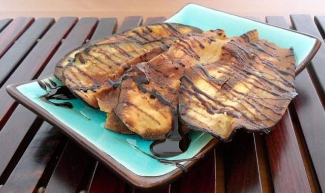 Chips de berenjena con miel de caña.