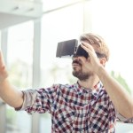 Young man with virtual reality headset.
