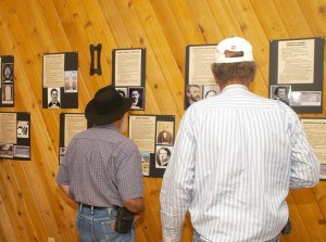 Family members view the history of their relatives who lived in Silver Reef during the heyday of mining. Photo by Burton Weast.