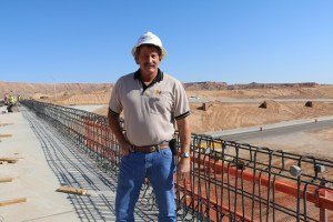 Mesquite Public Works Director Bill Tanner checks out the progress of I-15 Exit 118 interchange bridge as Meadow Valley Contractors finish the seven-month project in time for a July 21 grand opening. Photo by Barbara Ellestad.