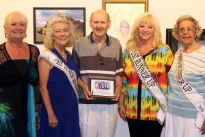 2016 Ms. Senior Mesquite and her court present videographer Paul Boussard with a special plaque to thank him for his years of dedicated service to the Ms. Senior Mesquite Pageant.  From left, Judy Brittain, Jean Hardman Ms. Senior Mesquite 2016, Paul Broussard, Gail Laird First Runner Up and Elizabeth Merrill Second Runner Up.  Photo by Teri Nehrenz