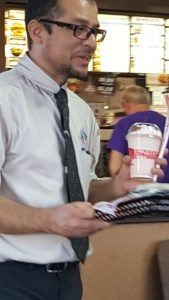Jorge Chavelas, Manager of Jack in the Box takes a milkshake to guest at a waiting table. photo by Teri Nehrenz