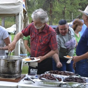 Powwow attendees including Diana and Bill Hottell, Shannon Fharnham and Don Goodman partake of the traditional meal. Photo by Laurelle Walsh