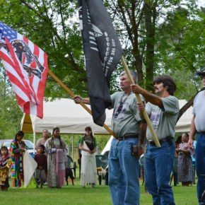 A color guard (led by William Robinson of Twisp and Jeff Nelson of Chelan) presented the Native American and POW/MIA flags honoring U.S. military veterans during the grand entry. Photo by Laurelle Walsh