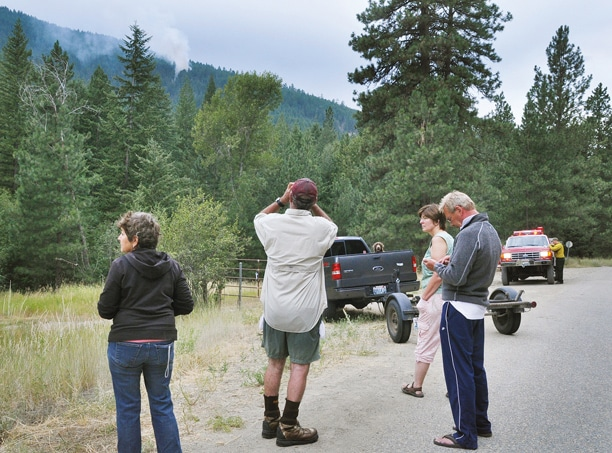 On Thursday (Aug. 1), a lightning strike above Blackpine Lake Road brought Judy Northcutt, left, Barry and Kathy Northcutt and Randy Chiabai out of their Libby Creek cabin to keep an eye on the resulting fire. Photo by Sue Misao