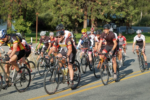 Riders nearly half-a-hundred strong head out from the Barn on Highway 20 at the start of last Sunday's 80-mile Gran Fondo Winthrop. Of the 49 who started the ride, 42 finished. Photo by Mike Maltais