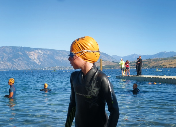 Liv Aspholm, in a wet suit to confront the cold waters of Lake Chelan, awaits the start of the Try-A-Tri 400-meter swim. Photo courtesy of David Aspholm