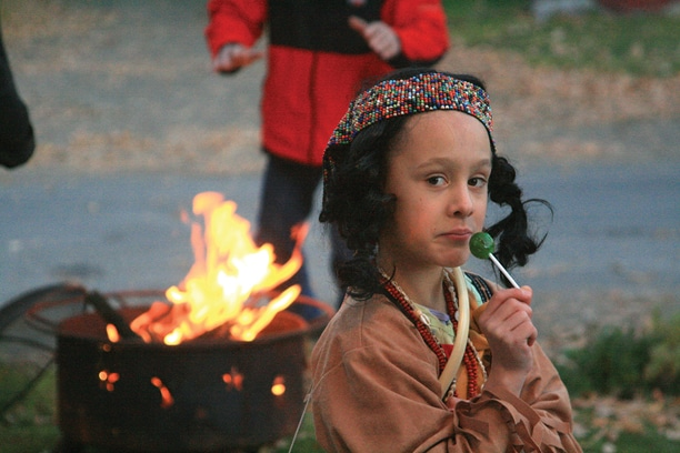 Nina Kominak took a lollipop break from her good works as Saint Kateri Tekakwitha, patron of the environment.