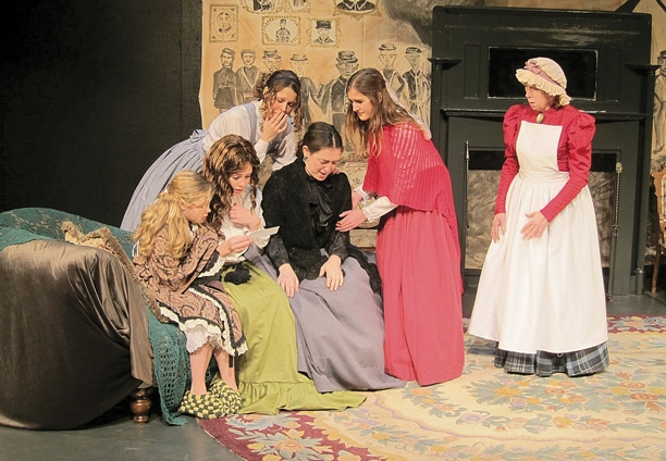 The March family gets bad news about the fate of Mr. March, who is fighting in the Civil War, in The Merc Playhouse production of Little Women that opens this Friday in Twisp. Filling the roles are, from left, Gretta Eberline as Amy, Amelia Eberline as Jo, Lori Ludeman as Meg, Jill Beckerman as Mrs. March, Cecelia Odell as Beth and Renda Grim as Hannah. Photo by Don Nelson