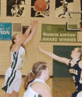 Freshman guard Lauren Fitzmaurice shoots a three-pointer over the outstretched arm of Oroville's Brittany Jewett during the Lady Lions' final game of the season last Friday in the Lions' den. Fitzmaurice scored 18 points for Liberty Bell in a 58-30 loss to the 10-1 Hornets, who lead the Central Washington B North division. Photo by Mike Maltais