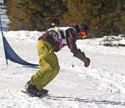 Loup Snowboard Team assistant coach Stephen Stiles cuts a corner on the slalom course in last weekend's fourth annual Loup Snowboard Races at the Loup Loup Ski Bowl. Shiles finished first in the senior men's slalom and second in the giant slalom. Photo by Mike Maltais