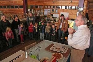 Editor Don Nelson, right, addresses the Head Start students. Photo by Darla Hussey