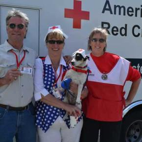 John and Renee Szenasi and Wendy Braden escort Stella, the official mascot of the North Cascades Chapter of the American Red Cross.Photo by Laurelle Walsh
