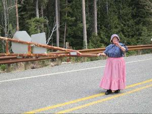 """Granny Winthrop"" – Georgia Sanders, hostess at the Winthrop Visitor   Information Center – helped open the gate to allow waiting motorists   to head over Washington Pass. Photo by Don Nelson"