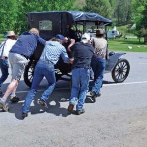 Push start. The Shafer Museum's 1914 Ford Model T needed a little help getting started at the museum's open house on Monday. Official driver John Owen gave rides to many visitors, include 92-year-old Hank Heckendorn, as well as a few driving lessons, Owen said. Photo by Laurelle Walsh