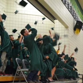 The Liberty Bell High School class of 2014 lets the mortarboards fly. Photo by Laurelle Walsh
