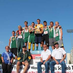 The boys' team accepts their second-place trophy on the podium. Photo by Lauren Fitzmaurice