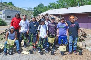 The students from Paschal Sherman Indian School who helped build the pit house are, from left, Joshua Esquejo (sitting) 9th grade (Colville Tribe),  Nathaniel Bigwolf 9th grade  (Colville Tribe), Nicholas Thomas 6th grade (Colville Tribe), Katlyn Watt 8th grade  (Colville Tribe), Shae Huckins 9th grade  (Colville Tribe),  Raymond Leaver, Principal (Standing behind), Forest Nash 8th grade  (Yakama Nation),  Joel Nash 8th grade  (Yakama Nation), Kendrick Yallup-Littlebull  (Yakama Nation). Photo by Laurelle Walsh
