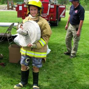 Lazo Gitchos, future volunteer firefighter with volunteer Captain, John Owen, right. Photo by Pat Leigh