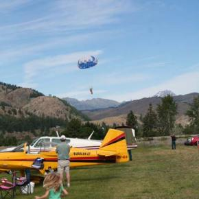 Eight smokejumpers made safe landings on the grassy field. Photo by Darla Hussey