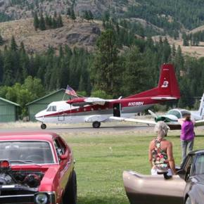 After eight smokejumpers made safe landings on the grassy field, their plane landed at the field for people to look at. Photo by Darla Hussey