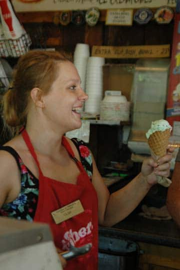 Photo by Ann McCreary Olga Zmuda of Wroclaw, Poland, hands an ice cream cone to a customer of Sheri's Sweet Shoppe, where she works.