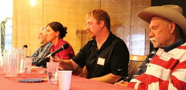 Photo by Don Nelson From left, Okanogan County commmissioner candidates Ray Campbell, Ashley Thrasher, Andy Hover and Stan Kvistad faced a large audience at Monday's public forum.