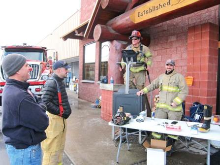 Photo by Don Nelson District 6 firefighters prepped for the stair climb at Hank's Harvest Foods last weekend.