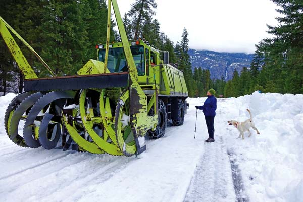 Photos courtesy of Pat Leigh Sherrie Krown and her dog Bennie visit with the driver of the blower while he waits for the plow to move some snow on Highway 20.