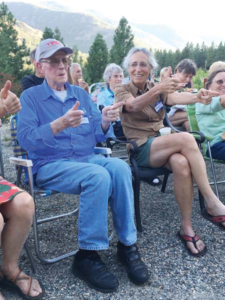 Photo courtesy of Deirdre Cassidy Ken Westman and Betsy Weiss enjoy a performance by a local comedy group during a recent Methow At Home potluck dinner.
