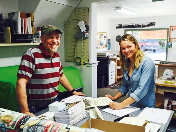 Photo by Ashley Lodato Jerome Thiel, left, and his wife, Kim, sold Riverside Printing in Winthrop to Virgina Nelson — on the right — and her husband, Ben.