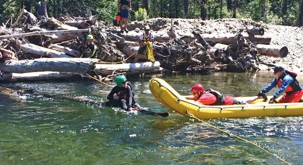 Photo courtesy of Aero Methow Rescue Service Members of the Okanogan County Swiftwater Rescue Team practice techniques during a recent training session on the Methow River.