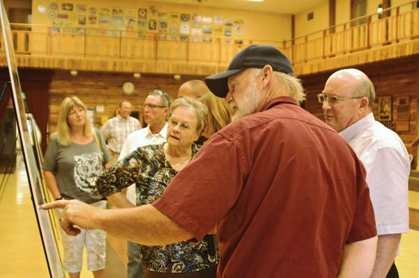 Photo by Ann McCreary Winthrop Town Council member Gaile Bryant-Cannon, left, and Sheri's Sweet Shoppe owner Doug Mohre examine proposed changes to Winthrop's four-way intersection during an open house hosted Aug. 17 by Washington State Department of Transportation.