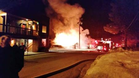 Photo courtesy of Laurie Porter Flames consumed the rear portion of the Twisp River Pub early Monday morning. The Twisp River Suites hotel, on the left, was evacuated for a time.