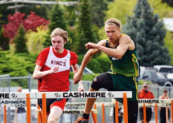 Photo courtesy of Erik Brooks Liberty Bell's Micah Klemmeck, in green, was intensely focused in the 110-meter hurdles race at Cashmere.