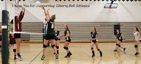 Photo by Don Nelson Emily Paul slammed the ball over the net against Waterville as, from left, Carlynn Treise, Katie Labanauskas, Erin Schuh, Devin Surface and Ruthann Matteson waited for a return.
