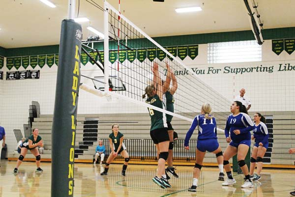 Photo Don Nelson Liberty Bell's Erin Schuh (No. 3) looks on as Emily Paul (No. 6) and Isabella Dinsmore (behind Paul)  battle at the net.
