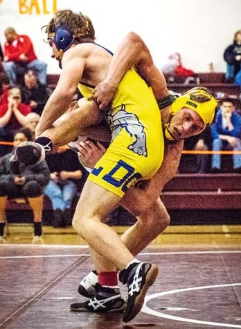 Photo courtesy of Mindy Miller Meritt Fink, in yellow headgear, took first place at 145 pounds.