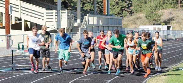 Photo by Don Nelson Members of Liberty Bell's cross-country teams started a time trial at a recent practice.