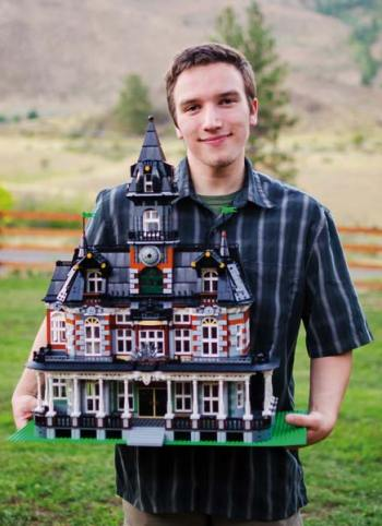 Photo by Mandi Donohue Logan Ellis with his Lego hotel.