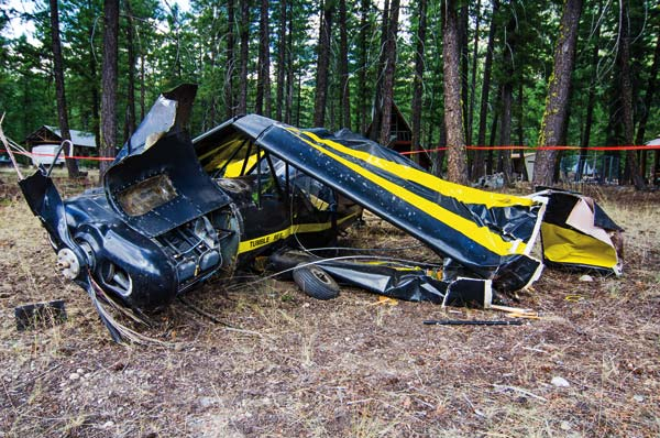 Photos by Mandi Donohue The Tumble Bee and its pilot — who walked away OK — crashed while taking off at the Lost River Airport last Saturday.