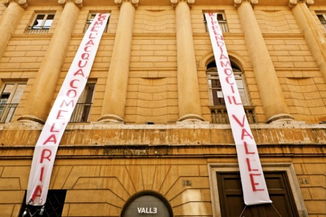 "Occupation of the Teatro Valle in Rome, 2011. The banner says, ""Like water, like air, let's take back the Valle."" Source: strugglesinitaly.wordpress.com"