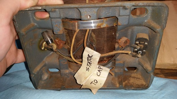 Capacitor bay, capacitor removed. Both those wires should say 'to cap' - I labeled them wrong. On the right is the power switch. The striped metal band is part of the center band.