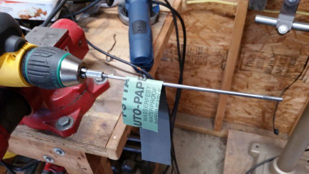 I used another coupler nut with a small section of threaded rod glued in with locktite to make a holder that I could chuck in my drill. By mounting the drill in my vise, I could clean up the through bolts.