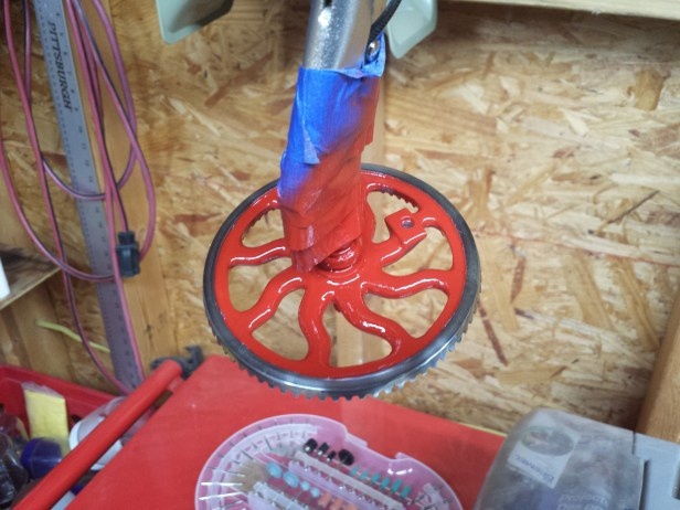 The wheel was cleaned up on a wire wheel on my bench grinder, and the spokes were sanded clean of paint. It's easier to sand blast the spokes clean, but I didn't have a blaster at this point.