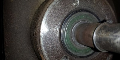 The bearing was not a lot of fun to remove.  I don't have a puller, so I just gently tapped until I got it loose.
