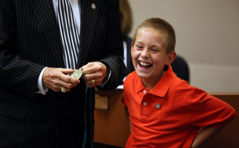 Salem Palmer, 10, reacts to seeing the Mayor's Medal of Appreciation that was later hung around his neck by Mayor Harvey Hall in recognition of Salem's quick action that saved the life of a classmate in the cafeteria at Highland Elementary School. 2012. Salem was recognized at the Standard School District board meeting on Tuesday night in Oildale. - The Bakersfield Californian